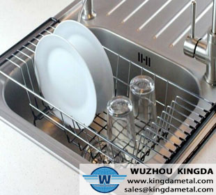 Metal dish drainer in sink